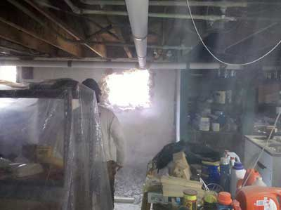 Access to the crawl space is through an opening jackhammered through the foundation wall
