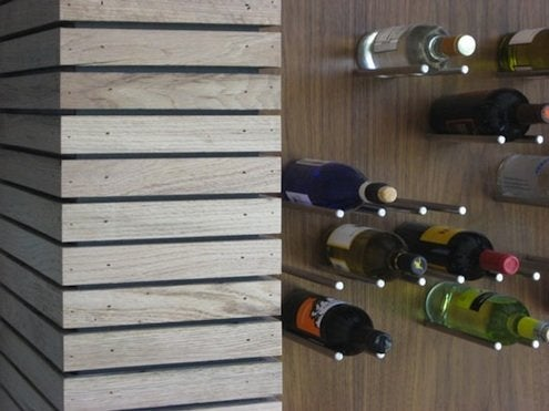ApartmentTherapy-FrameworkDesign-stainless-steel-rods-wine-rack