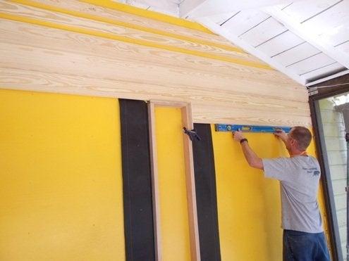 RenovationRaodTrip-86nit-making-sure-level-to-floor-BobVila-Photo10