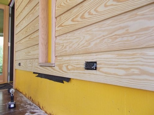 RenovationRoadTrip-86nit-Cutting-outlet-openings-in-siding-BobVila-Photo15