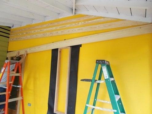 RenovationRoadTrip-86nit-installing-studs-BobVila-Photo8