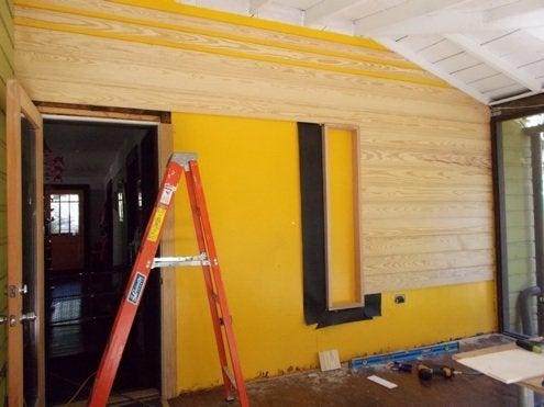 RenovationRoadTrip-86nit-installingsiding-BobVila-Photo11