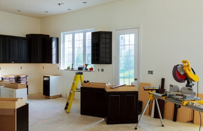 Installing Base Cabinets In The Kitchen