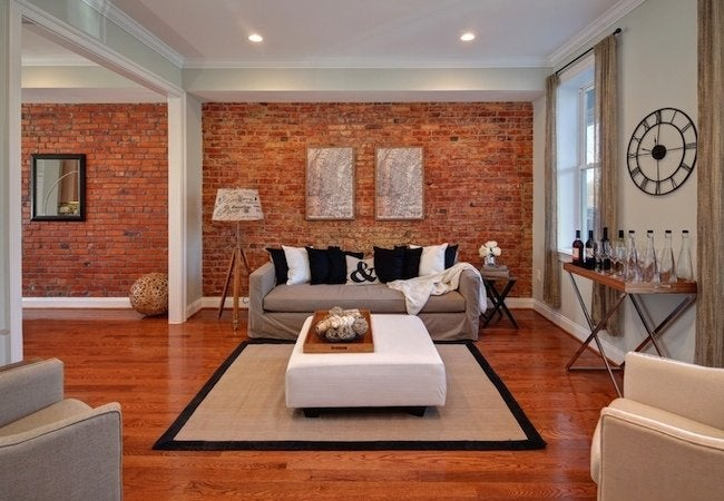 how to hang picture frames on a brick wall bob vila. Black Bedroom Furniture Sets. Home Design Ideas