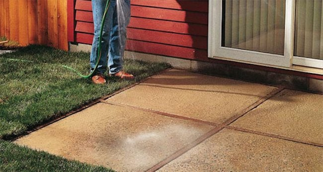 Diy concrete patio how to pour a slab bob vila for Pouring your own concrete driveway
