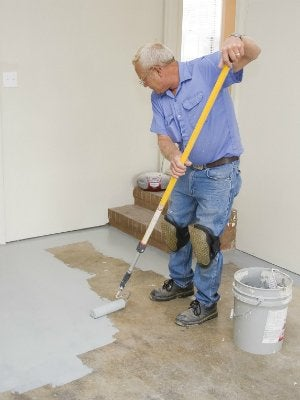How to Paint a Garage Floor - Rolling On Paint