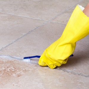 How To Seal Grout   Clean Grout With A Toothbrush