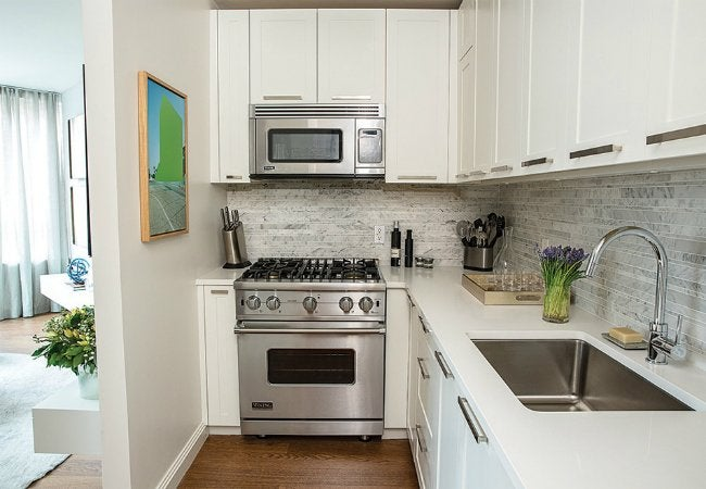 Painting laminate cabinets dos and don 39 ts bob vila for Laminate kitchen cabinets