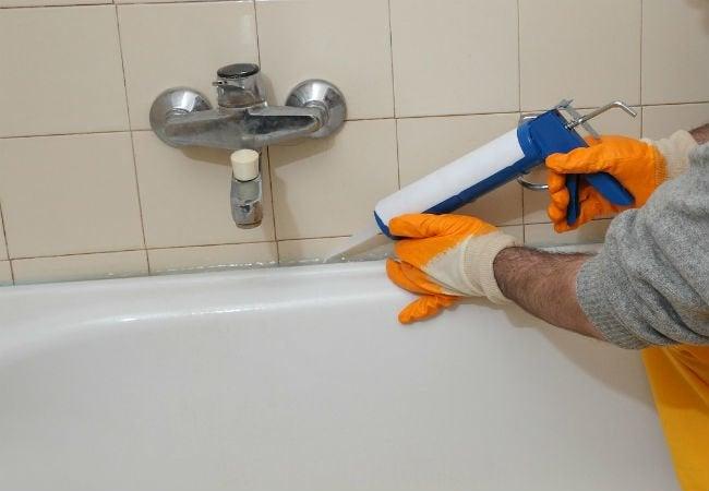 How To Caulk A Shower Bob Vila - Applying caulk to shower