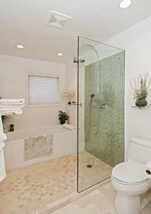 Tiling a Small Bathroom - Dos and Don'ts - Bob Vila on small master bathroom with shower, small bathrooms with shower only, small bathroom shower plans, small bath with shower, bathroom with slanted ceiling in shower, small bathroom layout, small bathroom interior design, large bathroom with shower, small bathroom design door, transom windows above bathroom shower, high-tech bathroom shower, small bathroom budget makeover, rustic bathroom ideas with walk-in shower, small bathroom tile design, small showers for small bathrooms, dimensions for small bathroom with shower, small bathroom colors, bathroom layouts with shower, mediterranean bathroom shower, small bathroom ideas,