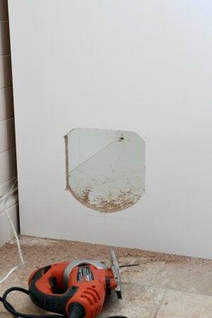 DIY Hidden Litterbox - Cutting the Hole for the Pet Door