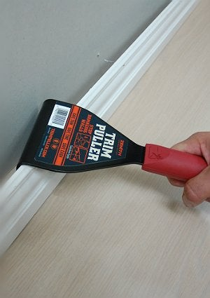 Removing Baseboard with the Help of a Trim Puller