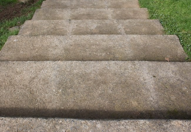 Bottom of steps flaking concrete