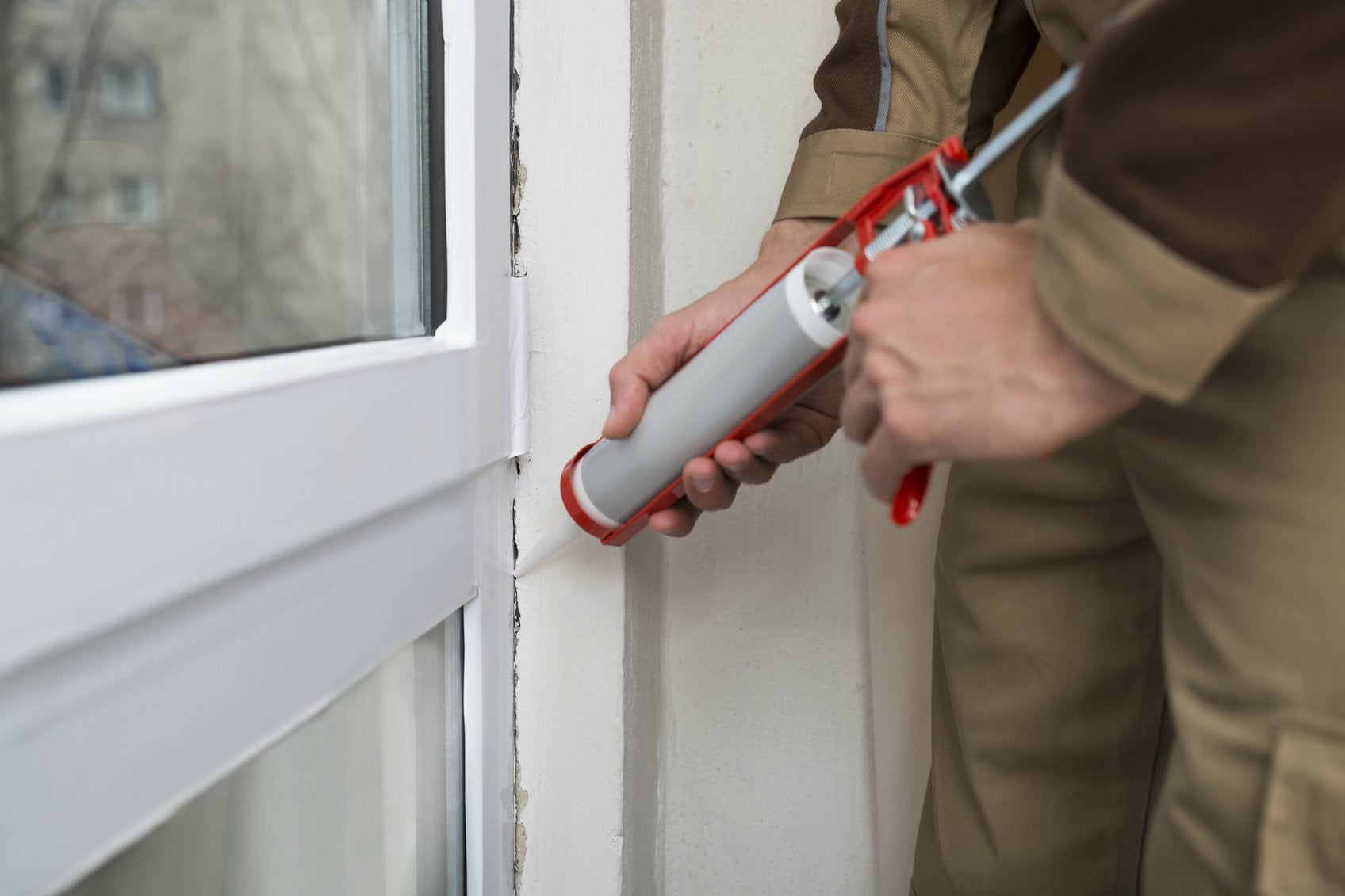 How to insulate windows bob vila for Window caulking