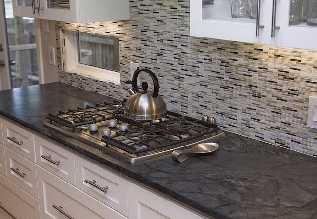 Soapstone Countertops - All You Need to Know - Bob Vila on black countertops, copper countertops, paperstone countertops, granite countertops, agate countertops, concrete countertops, silestone countertops, solid surface countertops, obsidian countertops, metal countertops, quartz countertops, bamboo countertops, marble countertops, gray limestone countertops, kitchen countertops, stone countertops, hanstone countertops, butcher block countertops, slate countertops, corian countertops,