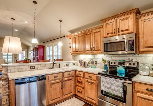 How to glaze kitchen cabinets bob vila for Can you paint non wood kitchen cabinets
