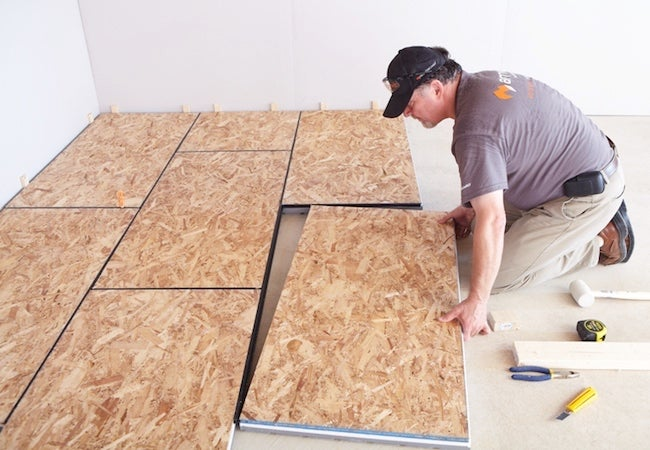 The secret to a warmer drier faster finished basement for Best basement floor insulation