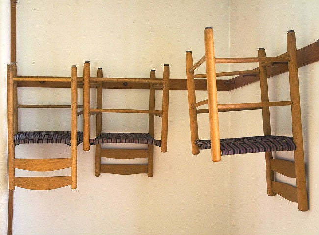 Shaker Style Chairs Hung on the Walls