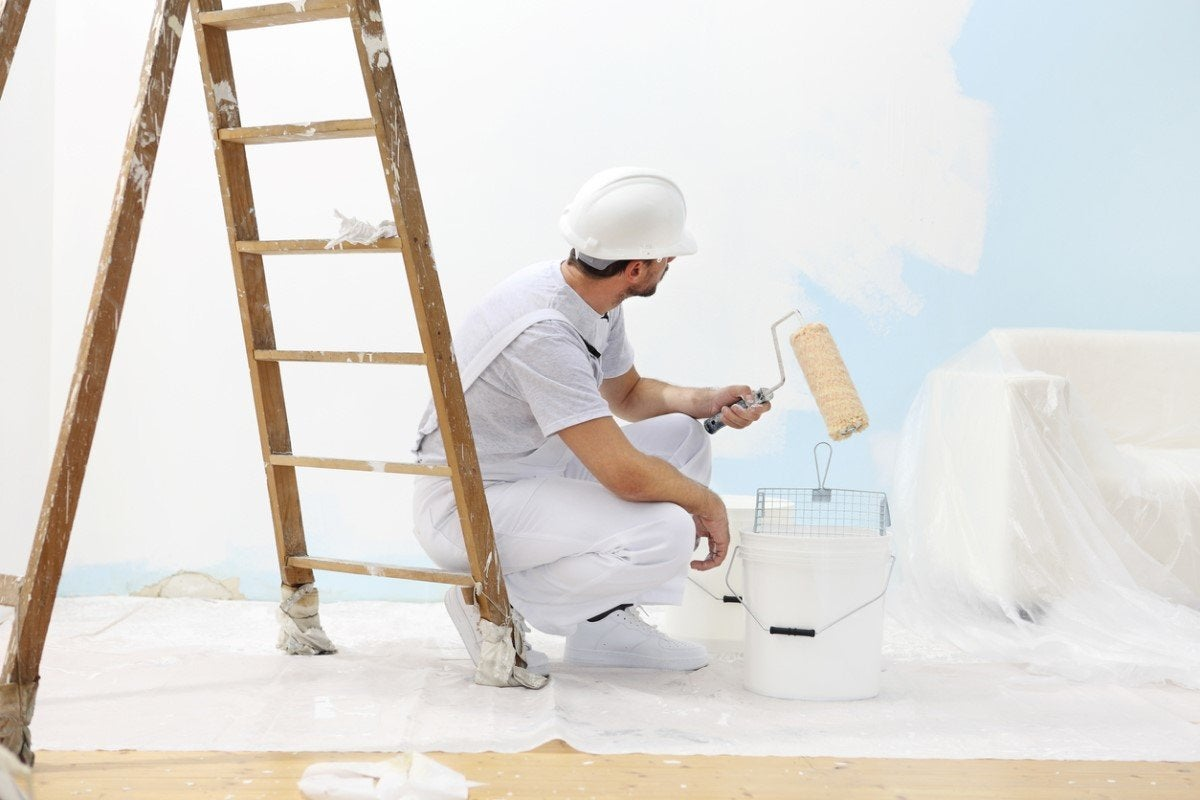 Why Do Painters Wear White? Solved!