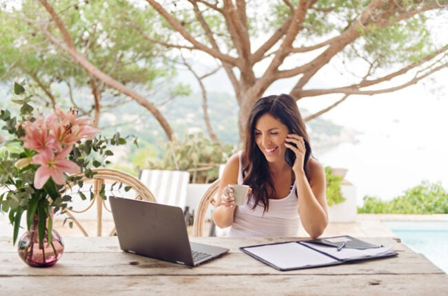 woman working remotely from Airbnb