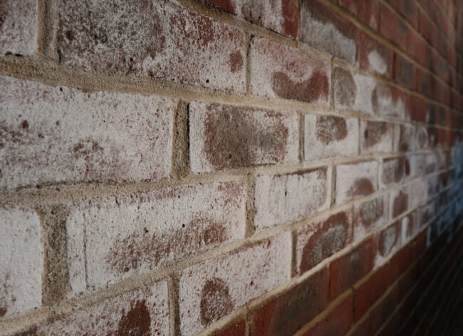 efflorescence on brick exterior