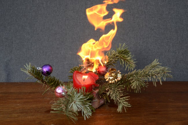holiday candle on fire