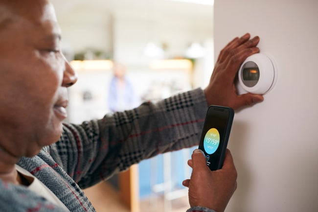 adjusting smart thermostat