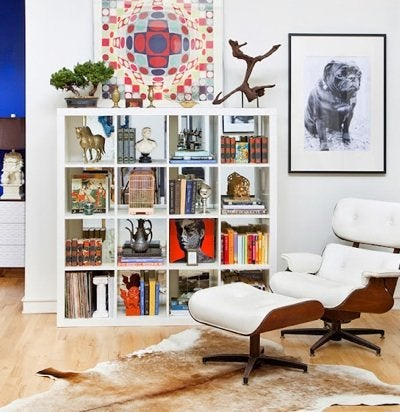 Design Manifest Interior with Bookshelf and Eames Chair