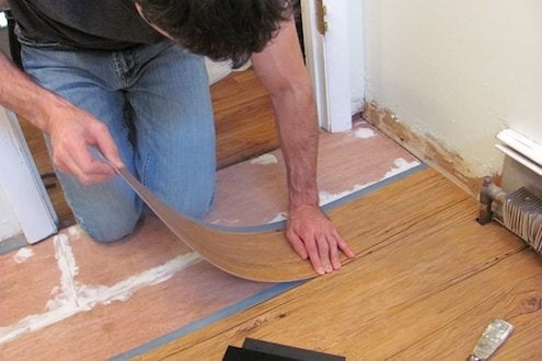 how to replace linoleum floor in bathroom how to install vinyl plank flooring bob vila 26219
