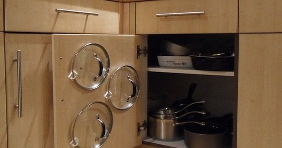 Clever uses for hooks   pots and pan lids
