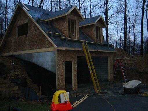 I give up garage basement built into hillside in for Building a garage on a sloped lot