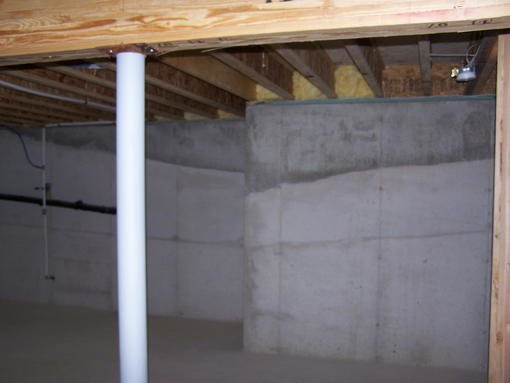 Poured concrete walls : Poured concrete basement wall is layered forum bob vila