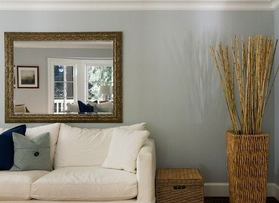 Small Space Decorating Tricks: Mirror Makes Room Look Bigger