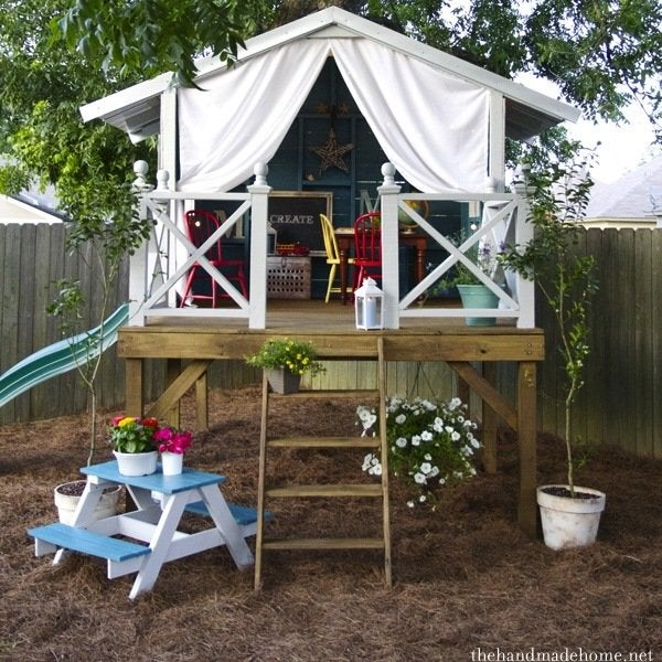 DIY Playhouse - 8 Inventive Ideas - Bob Vila on boat yard designs, great playground designs, indoor pool designs, game room designs, new management designs, master bedroom designs, party deck designs, community wall designs, workout facility designs, laundry room designs, wall to wall carpeting designs, korean house plans and designs, covered carport designs, doorman designs, jungle pool designs, guard gate designs, hot tub designs, basketball court designs, tree house designs, indoor gym designs,