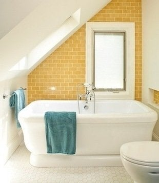 Renewal designbuild bathroom yellow subway tiles