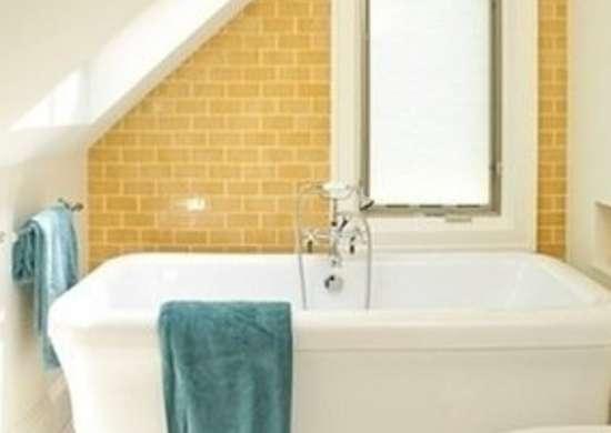 Renewal designbuild bathroom yellow subway tiles
