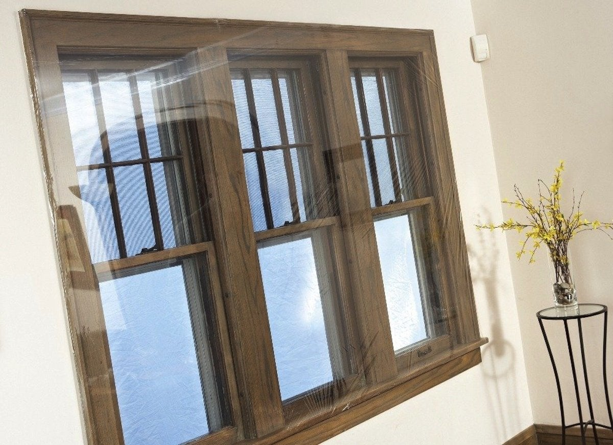 Drafty windows 8 ways to stop the cold bob vila for Best insulated glass windows