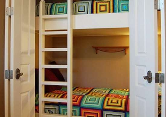Bed in closet closet ideas convert your space bob vila for Transform small closet space