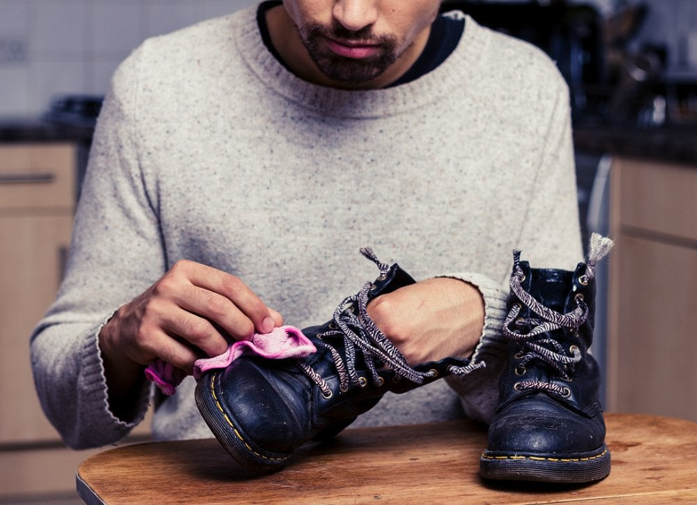 Man polishing shoes | Interesting Uses For WD-40 DIY Junkies Should Know