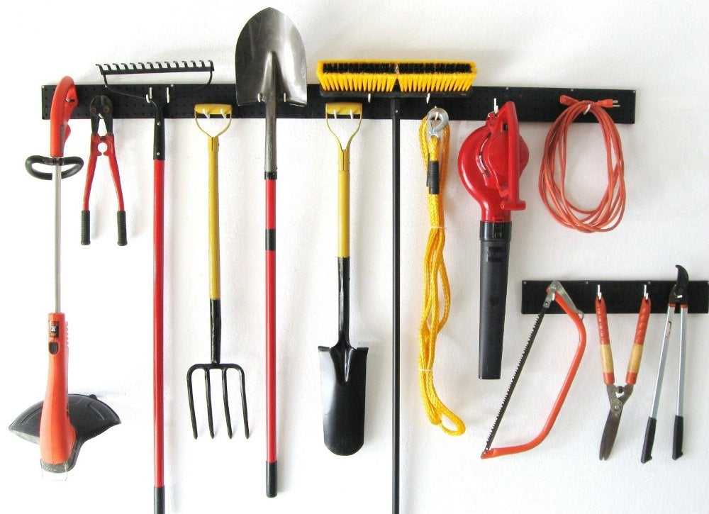 Garage storage ideas 10 organizers for a tidy garage for Gardening tools 6 letters