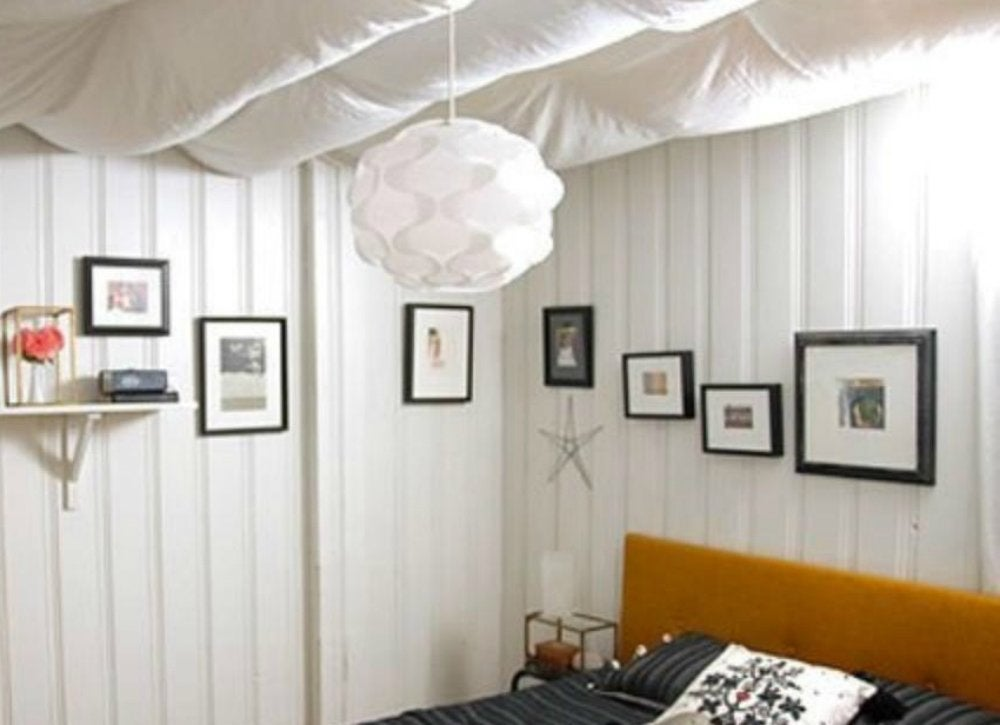 If The Rafter Ceiling In Your Unfinished Basement Feels Too Cold And  Industrial For Your Taste, Soften It By Hanging Swaths Of Fabric To Create  A Beautiful ...