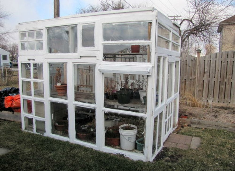 Old window greenhouse old window frames 7 new ways to for Ways to use old windows