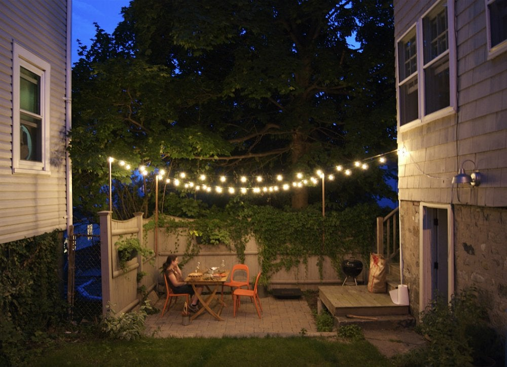 Outdoor string lights small backyard ideas 9 ideas to make yours feel grand bob vila - How to use lights to decorate your patio ...