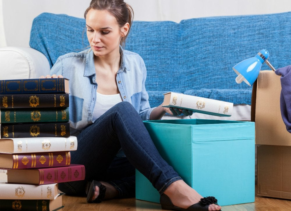 Filling a box of books