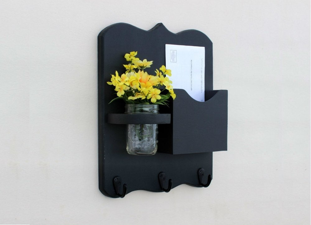 Entryway ideas 7 essentials for an organized foyer bob vila heres an small but mighty organizer that tidies unruly mail and adds instant cheer keep the mason jar portion of this hanging mail station filled with solutioingenieria Images