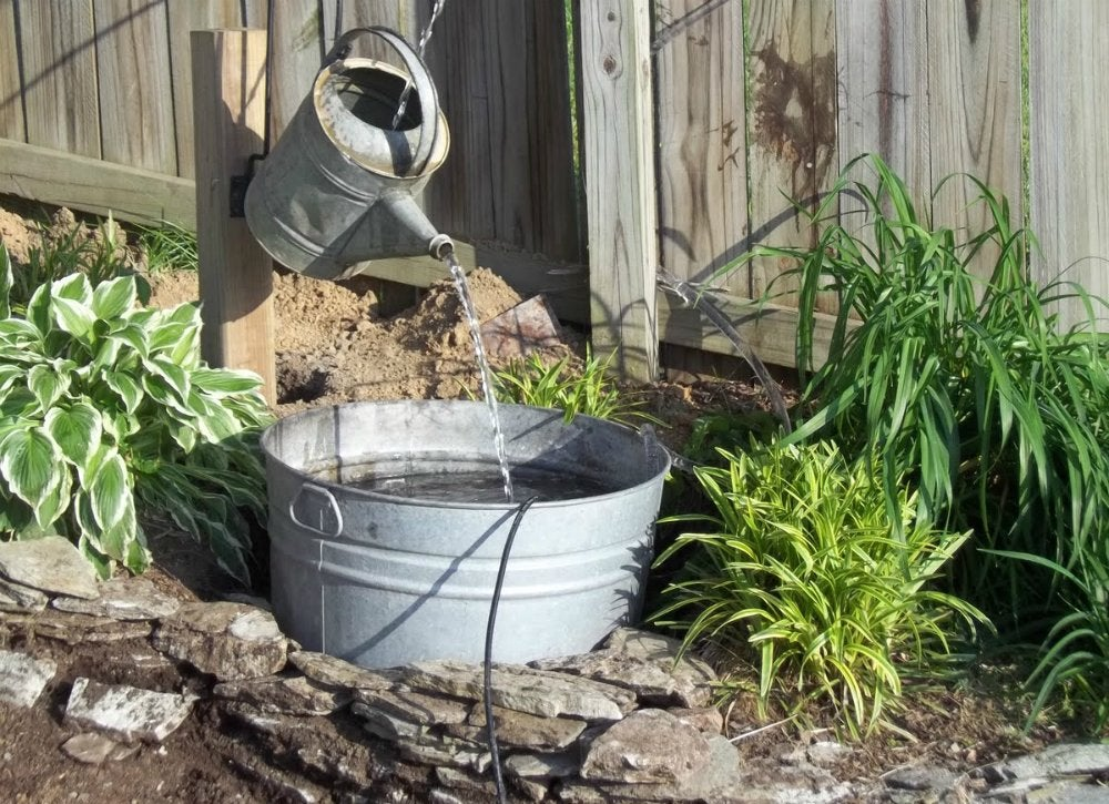 Vintage watering can diy fountain ideas 10 creative for How to make an outdoor fountain