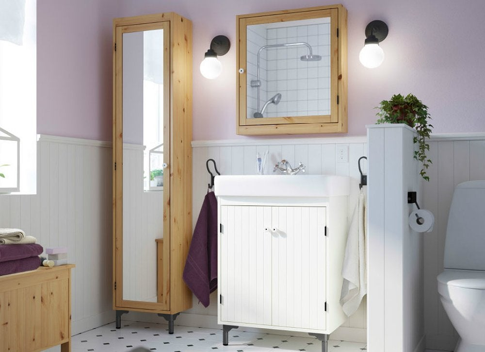 Mirrors Are A Key Element In The Home Design Bag Of Tricksu2014and Especially  Appropriate For A Small Bath. Note How This Tall Storage Cabinet Looms Less  Large ...