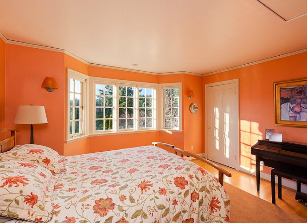 It May Seem Counterintuitive To Choose A And Bold Color For Small Room But Can Work Painting E Saturated Orange Will Draw The Focus