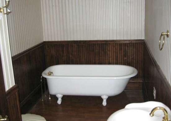 Small bathroom makeovers before and after bob vila for Wood panelling bathroom ideas