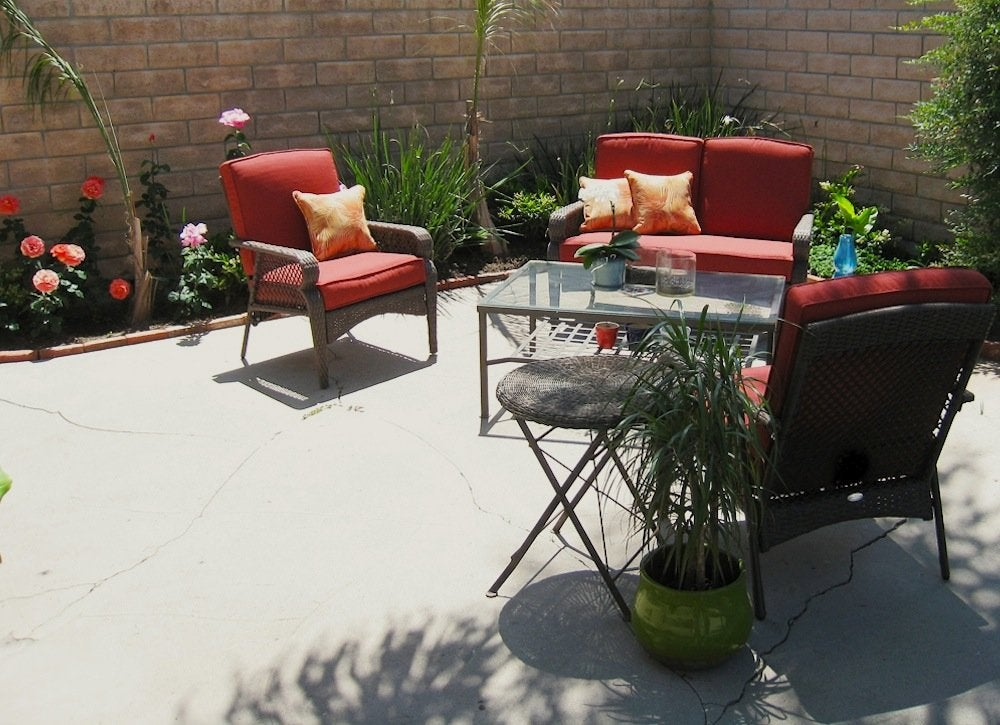 Concrete Patio - Backyard Landscape Ideas - 8 Lawn-Less ... on Backyard Ideas Concrete And Grass id=17391